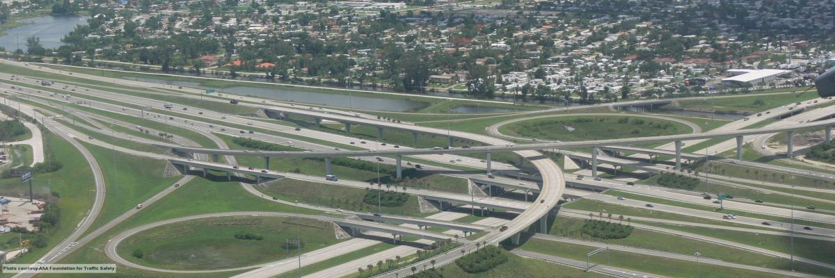 Highway interchange viewed from plane window